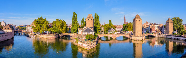 Panoramic view of the Ponts Couverts (covered bridges), a medieval set of bridges and defensive towers on the river Ill at the entrance of the Petite France historic quarter in Strasbourg, France. Fotomurales