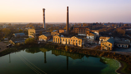 Aerial view of an old factory ruin and broken windows. Old industrial building for demolition.