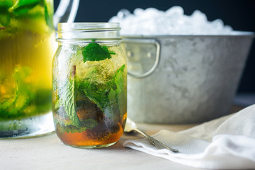 Mint julep in a glass jar.