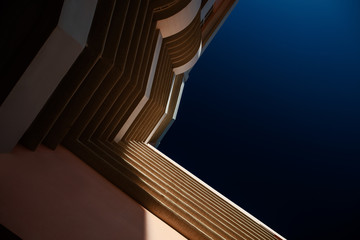 Architecture photograph of modern building viewed from below.