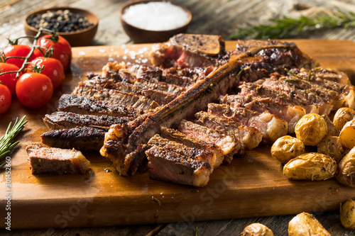 Wall mural Homemade Grass Fed Cut Up T Bone Steak