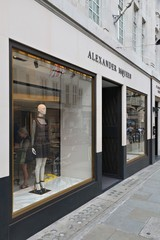 LONDON, UK - JULY 9, 2016: Alexander McQueen fashion shop at Old Bond Street in London. Bond Street is a major shopping street in the West End of London.