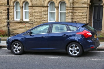 YORKSHIRE, UK - JULY 11, 2016: Ford Focus compact hatchback (3rd generation) car parked in Saltaire, Yorkshire, UK. Ford manufactured 6,396,369 cars in 2015.