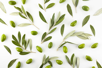 Pattern with green olive fruits with leaves on white background. Top view.