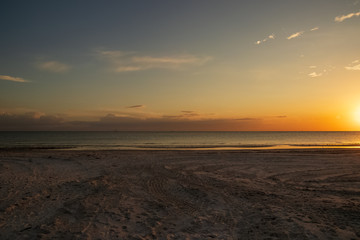 Empty, open beach scene at sunset on Fort Myers Beach, FL along Gulf of Mexico