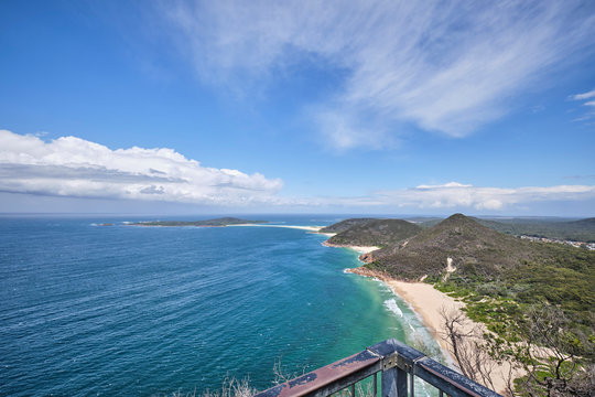Port Stephens Tomaree National Park looking over islands with blue sky and blue water