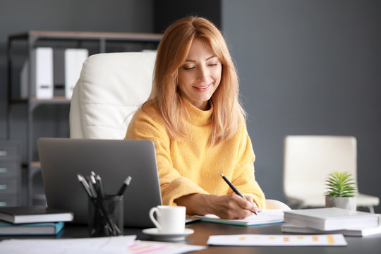 Portrait of mature businesswoman working in office