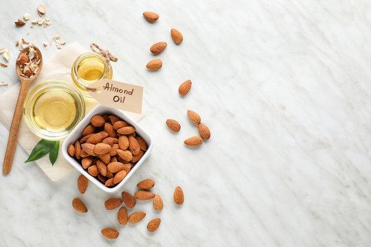 Tasty almond oil on white background