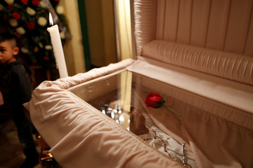 A rose is seen on top of the coffin of Maria Trinidad during her funeral in San Miguelito