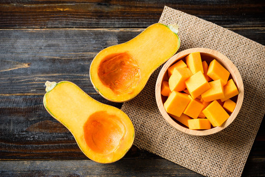 Half and slice butternut squash in a bowl for cooking