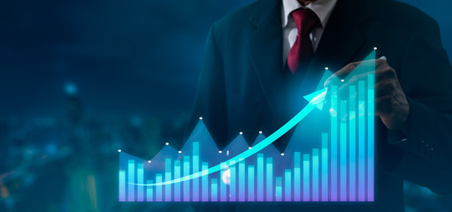 Businessman pointing arrow graph corporate future growth plan,hand with stock financial chart symbols coming from hand.Business development to success,growing growth and Investment concept.