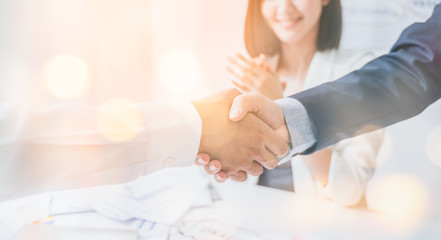 Teamwork,partnership and Social connection in business join hand together,Finishing up a meeting,handshake of happy business people after contract agreement to become a partner,collaborative teamwork.