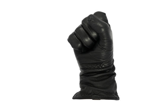 Hand in black leather glove making a fist, isolated on a white background. Good luck sign or threatening gesture. Copy space