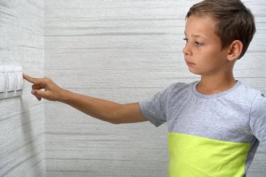 Kid turns off light