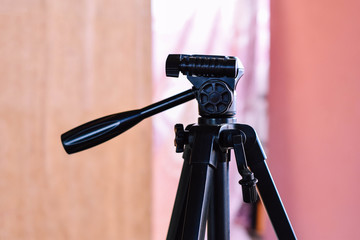 A close up of a tripod
