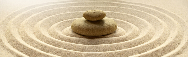 Foto auf Acrylglas Zen-Steine in den Sand zen garden meditation stone background with stones and lines in sand for relaxation balance and harmony spirituality or spa wellness