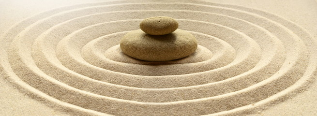 Poster Stones in Sand zen garden meditation stone background with stones and lines in sand for relaxation balance and harmony spirituality or spa wellness
