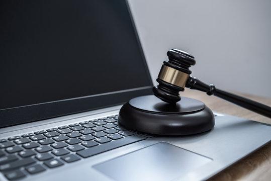 Law on laptop, cybercrime concept illustration