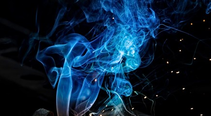 Aluminium Prints Fractal waves Colorful smoke of blue on a black isolated background.