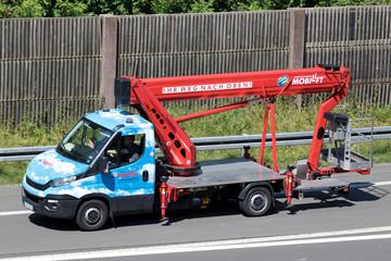 WIEHL, GERMANY - JUNE 24, 2019: Mobilift cherry picker van on motorway.