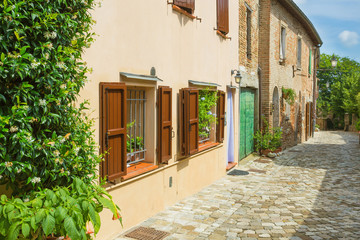 Fototapete -  Italian street in a small provincial town of Tuscan