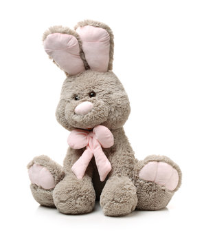 Old rabbit toy isolated on wood background