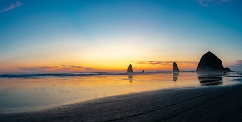 Sunset at Haystack Rock panorama in Cannon Beach Oregon