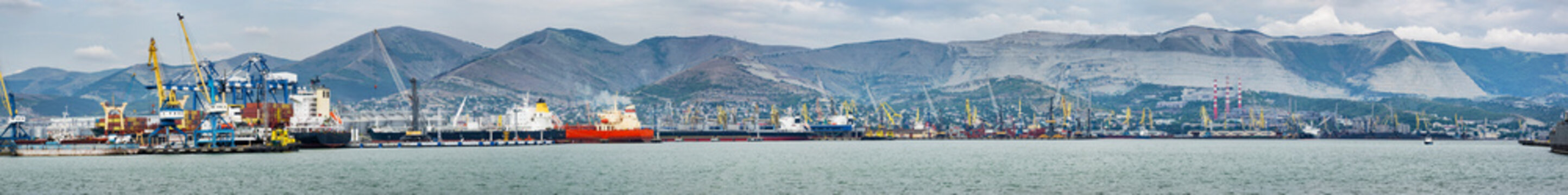 Commercial, industrial port, at the foot of the mountains, panorama