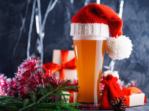 Christmas beer in a glass in Santa's hat