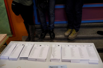 Photographers take pictures of ballots in a polling station ahead of general election in Madrid