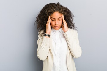 Young african american business woman touching temples and having headache.