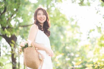 Asian beautiful women smiling in city public park morning light