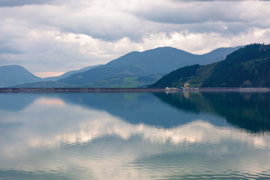 liptovska mara lake in the evening. cloudy springtime weather above the distant mountains reflecting in the calm water. popular travel destination of slovakia