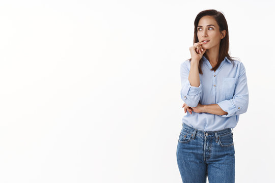 Thoughtful intrigued good-looking caucasian adult lady entrepreneur have interesting thought, look left interested pondering, touch chin, searching inspiration, have idea mind, stand white background