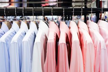Colorful shirts hanging on rack