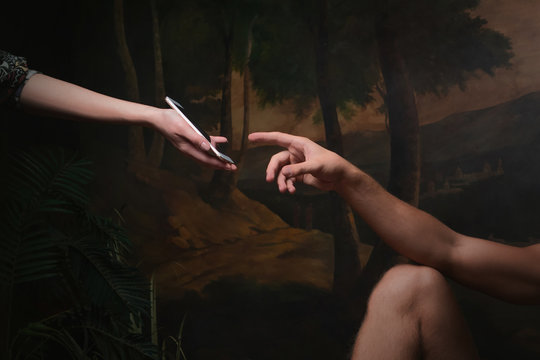 Smartphone screen touch, fingerprint recognition, concept. A funny remake of the creation of Adam,