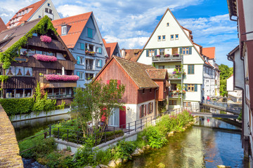 Fototapete - Ulm cityscape, Germany. Vintage houses in old town of Ulm. Scenic view of historical Fisherman`s Quarter in summer. It is a landmark of Ulm. Ancient city district with canals and small rivers.