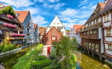 Fototapete - Vintage street in old town of Ulm, Germany. Scenic view of historical Fisherman`s Quarter in summer. It is a landmark of Ulm. Panorama of ancient district of Ulm city with beautiful houses and canals.