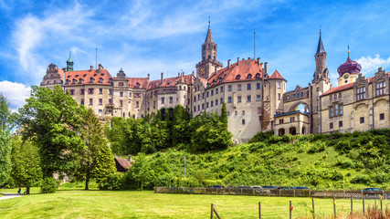 Fototapete - Sigmaringen Castle in summer, Germany. This famous Gothic castle is a landmark of Baden-Wurttemberg. Panorama of old German castle on a hill. Scenic view of beautiful medieval palace on sunny day.