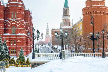 Fototapete - Moscow Kremlin during snowfall, Russia. View from snowy Manezhnaya Square. Famous ancient Moscow Kremlin is a top landmark of Moscow city. Scenery of old central Moscow in winter.