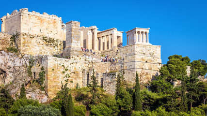 Fototapete - Acropolis of Athens in summer, Greece. It is a main tourist attraction of old Athens. Panoramic view of famous ancient Propylaea. Scenery of classical Greek ruins in the Athens center on sunny day.