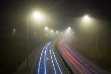 Fog over the night road Fotomurales