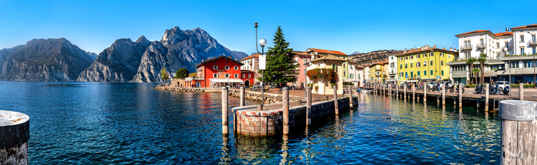 Papiers peints Navire View of Torbole at the lakeside of Lake Garda in summer in the northern Italy. Torbole is a popular holiday location in Italy.