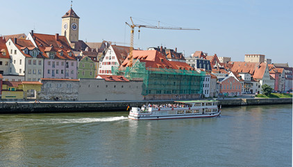 Tour boat on the River Danube at the medieval town of Regensburg, Bavaria, Germany