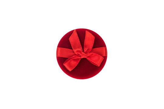 Round red closed jewelry box on a white background. Top view
