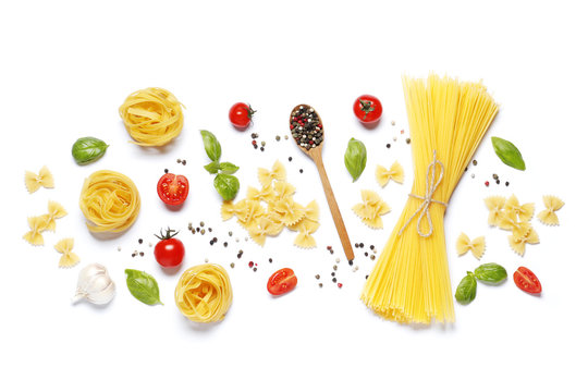 Flat lay composition of raw different pasta, fettuccine balls, cherry tomatoes,  spices, basil, olive oil, garlic isolated on a white background.
