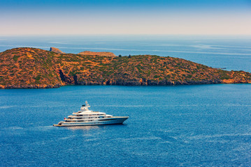 Large luxury white yacht off the coast of Crete, Greece.