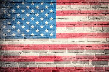 Grunge USA flag on brick wall background