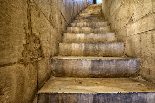 Stone steps. Old staircase leading up towards the light.