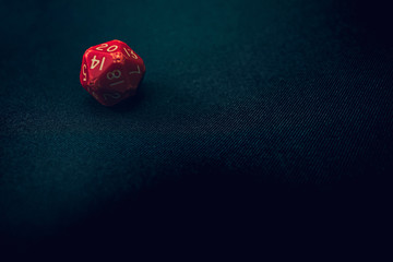 Old 20 sided die with 20 face up